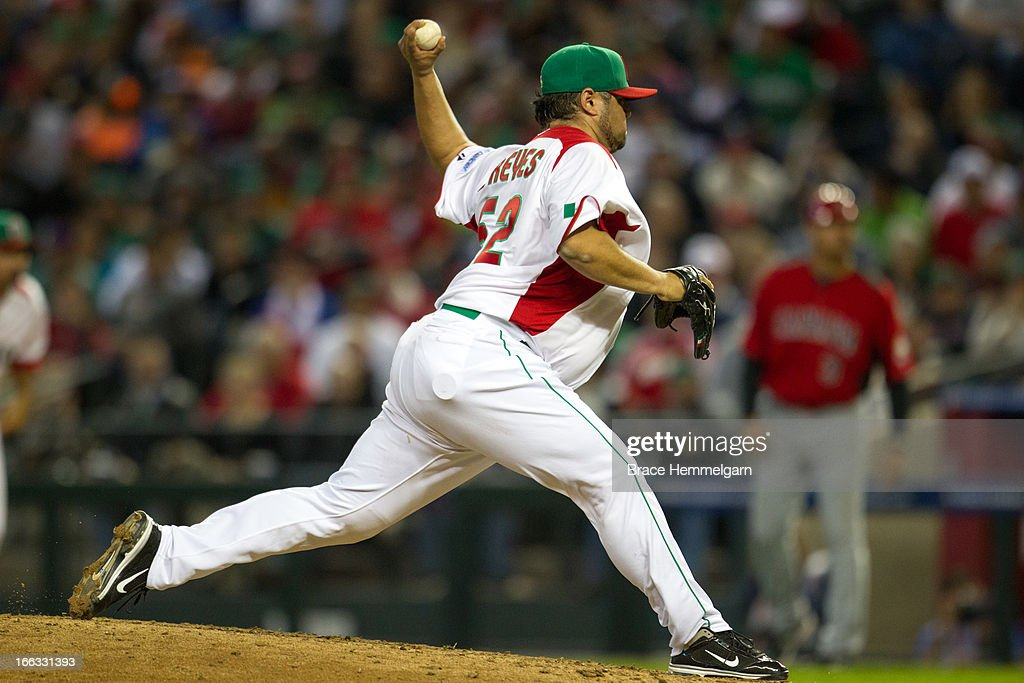 <a gi-track='captionPersonalityLinkClicked' href=/galleries/search?phrase=Dennys+Reyes&family=editorial&specificpeople=216363 ng-click='$event.stopPropagation()'>Dennys Reyes</a> #52 of Mexico pitches against Canada during the World Baseball Classic First Round Group D game on March 9, 2013 at Chase Field in Phoenix, Arizona.