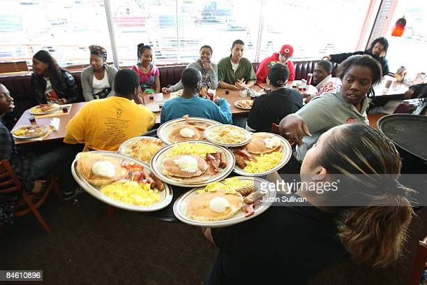 Denny's waitresses deliver free Grand Slam breakfasts to customers February 3 2009 in Emeryville California People lined up at Denny's across North...