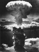 A dense column of smoke rises more than 60000 feet into the air over the Japanese industrial port of Nagasaki the result of an atomic bomb the second...