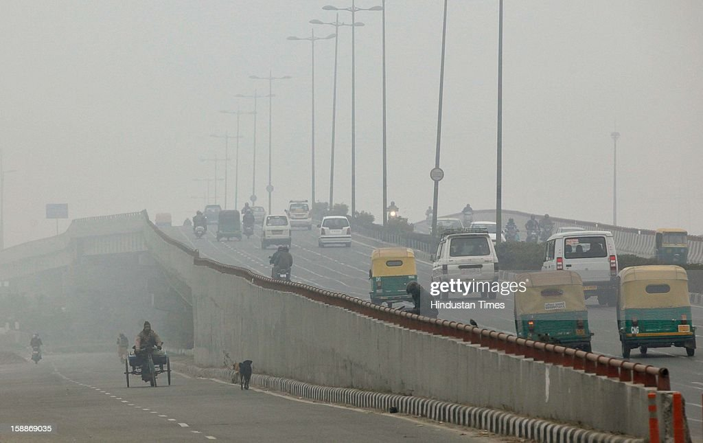 Dense fog at Mayur vihar, as temperature dips below 6 degree Celsius on January 2, 2013 in New Delhi, India. There was no respite from cold and dense fog in North India as mercury dipped two degrees below normal to stay at 4.8 degree Celsius.