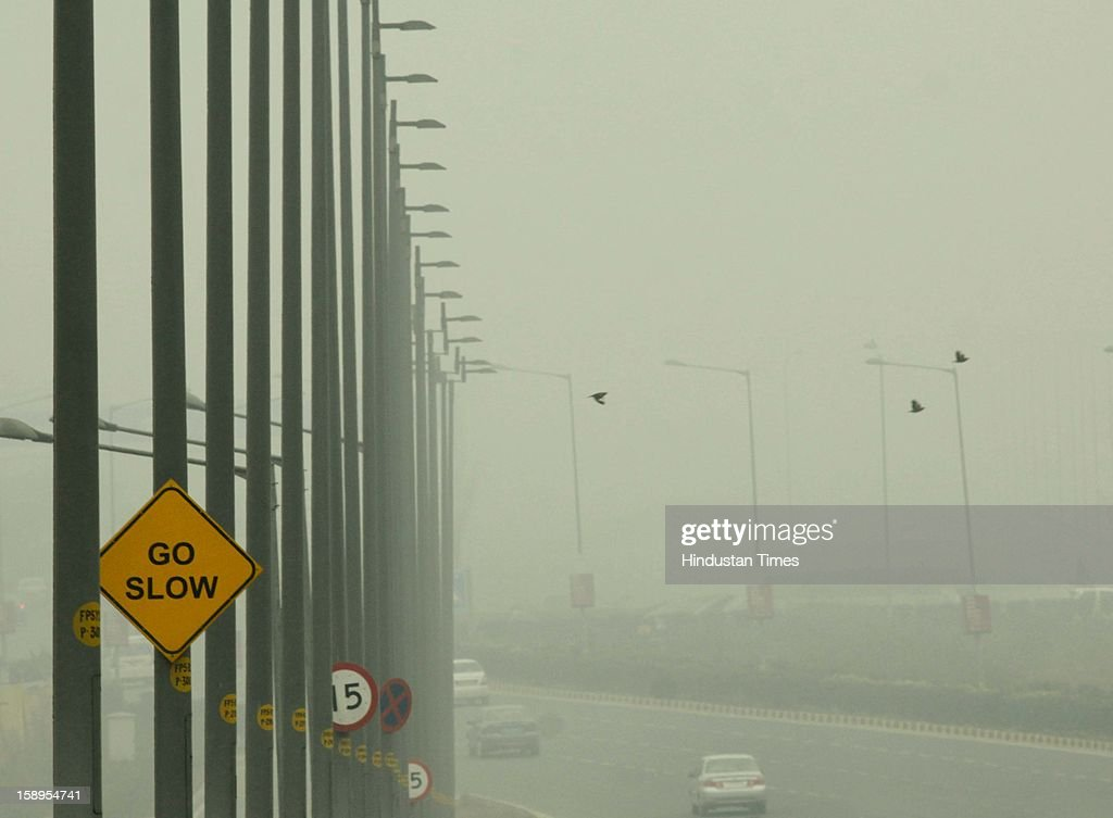 Dense fog engulf the area around Delhi International Airport as Mercury dips further to below 3 degrees on Friday Morning on January 4, 2013 in New Delhi, India. Dense fog has affected around 45 trains and 22 flights.