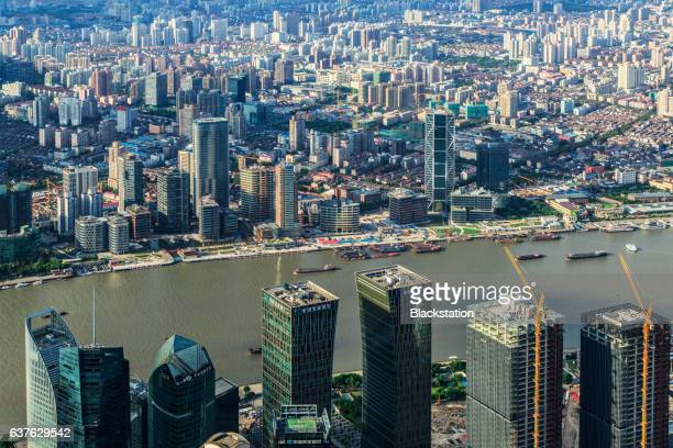 dense office buildings on both sides of Pujiang