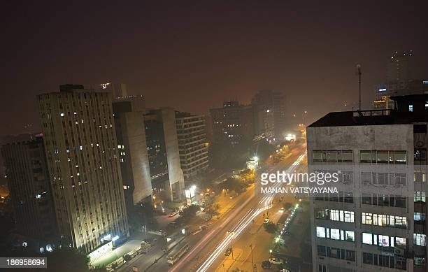 Dense smog covers the Indian capital's skyline as evening sets in New Delhi on November 5 2013 The toxic air pollutant sulphur dioxide has breached...