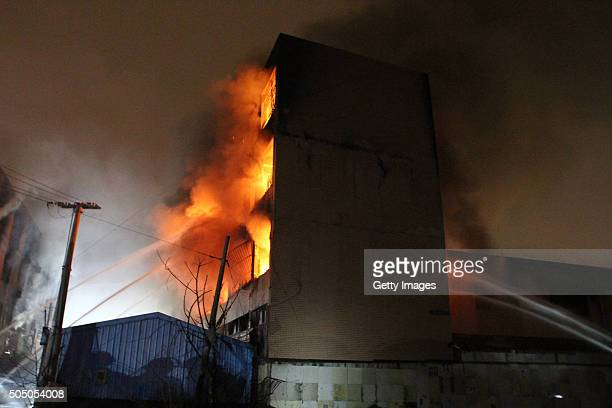 Dense smoke and fire rise as a truck carrying gas bottles get blasted which results in the burning of a joint fourstory factory building on January...