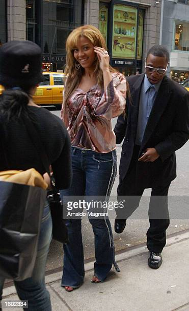 Denstiny's Child singer Beyonce Knowles smiles after shopping at Barney's on Madison Ave October 27 2002 in New York City