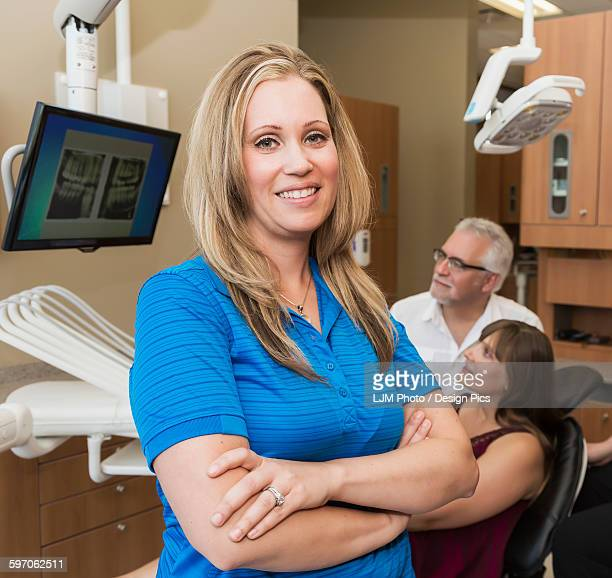 Dental assistant posing during dental consultation with patient
