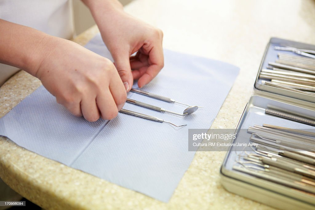 Dental assistant preparing instruments, close up