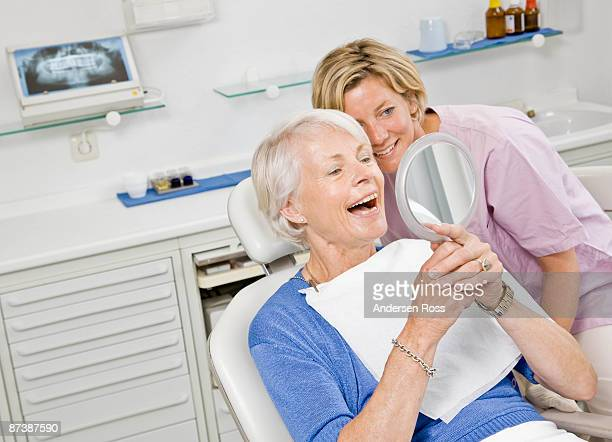 Dental assistant working on patient