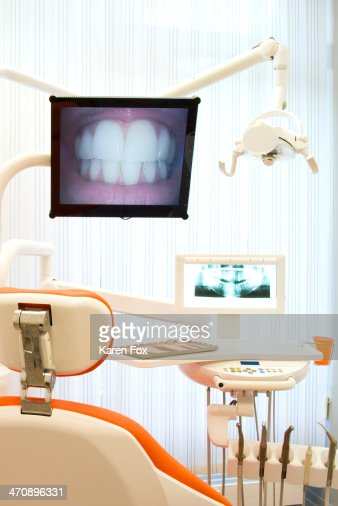 Dental clinic and computer monitors with pictures of teeth