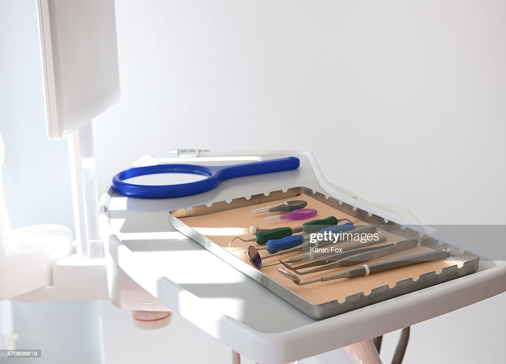 Dental clinic with surgical tray and equipment