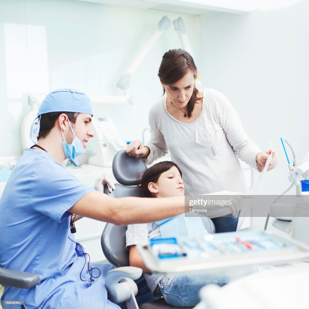 Dental health doctor and child patient. : Stock Photo