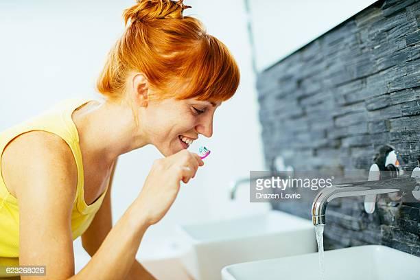 Dental hygiene in morning in bathroom