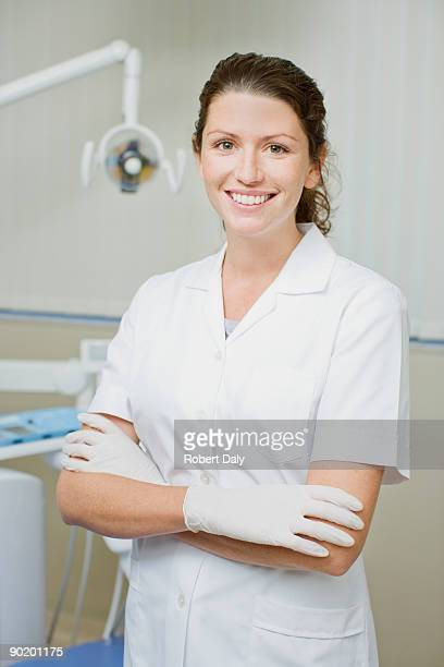 Dental hygienist standing in dentists examination room