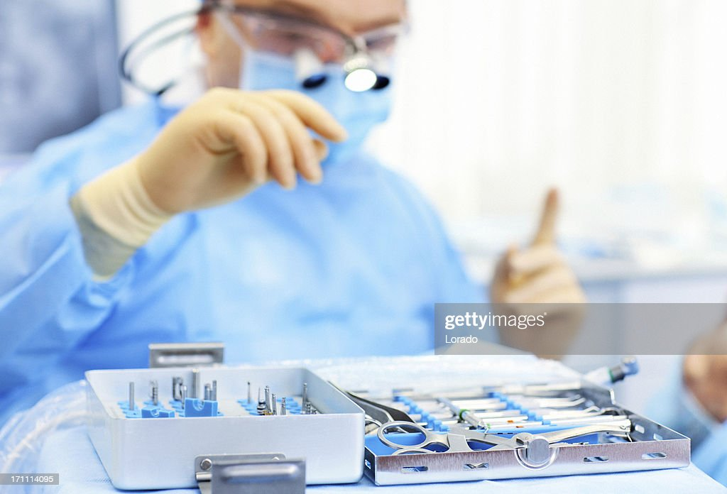 dental surgeon choosing equipment : Stock Photo