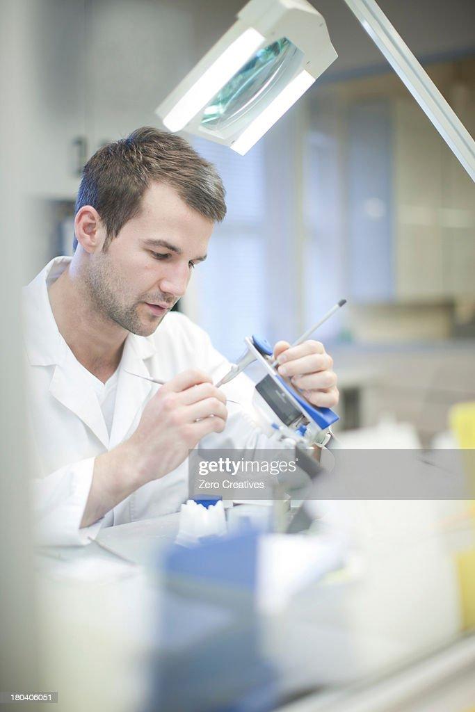 Dental technician making denture