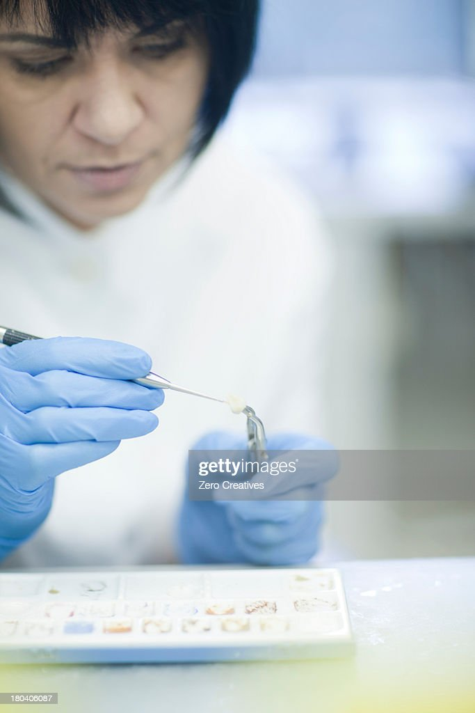 Dental technician working on false tooth