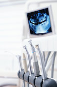 Dental tools against computer monitor