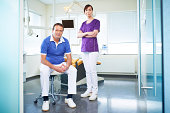 Dentist and a dental assistant