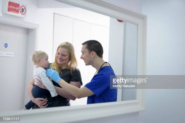 Dentist checking childs teeth in dental surgery