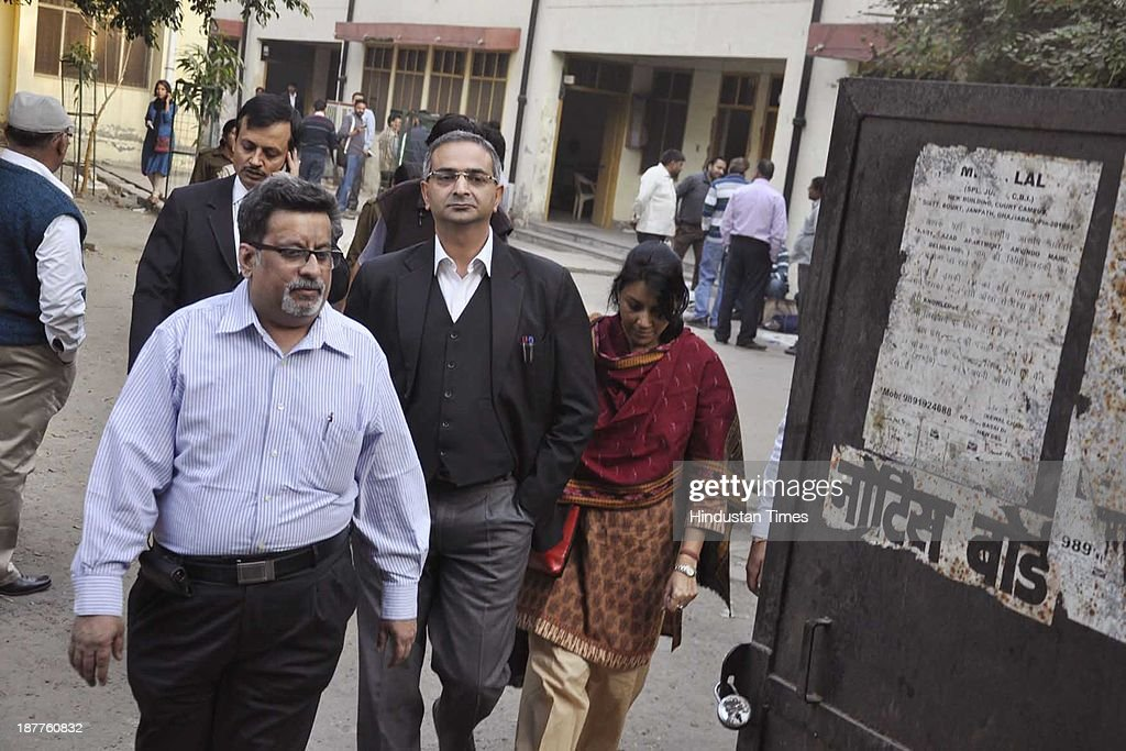 Dentist couple Nupur Talwar and Rajesh Talwar accused in Aarushi-Hemraj double murder case at CBI Court on November 12, 2013 in Ghaziabad, India. The verdict in the Aarushi-Hemraj double murder case will be ronounced November 25, a special CBI court hearing the case.