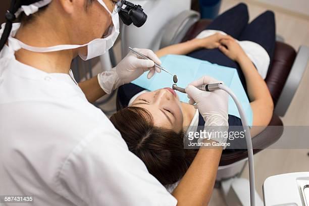 Dentist examines patients teeth