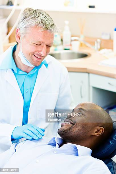 Dentist smiles reassuringly at patient who seems relaxed