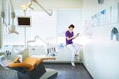 Dentist using a digital tablet