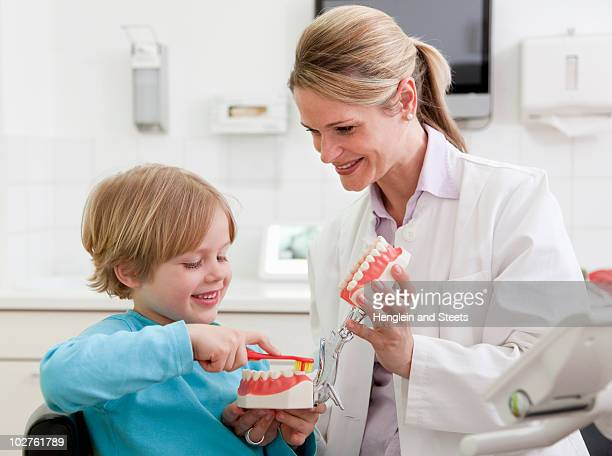 Dentist with boy in surgery