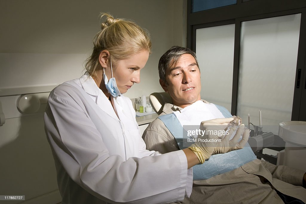 Dentist with patient : Stock Photo