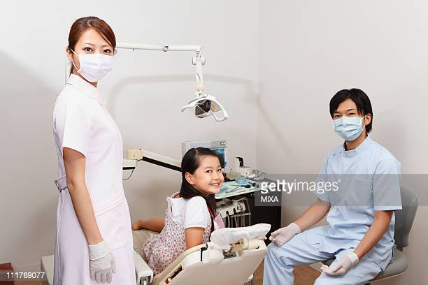 Dentists and Girl Smiling