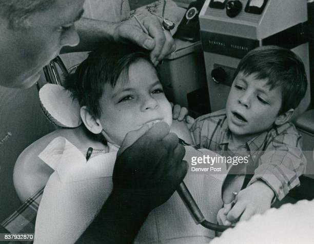 Dentists Dr Walter F Morrison Jr and his equipment aren't nearly as frightening for Greg when his friend Mike is the man in that big chari Credit...