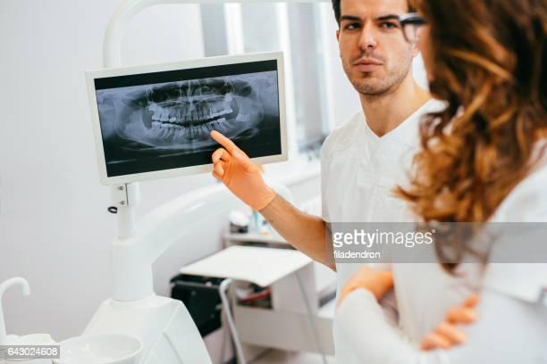 Dentists looking at a digital x-ray