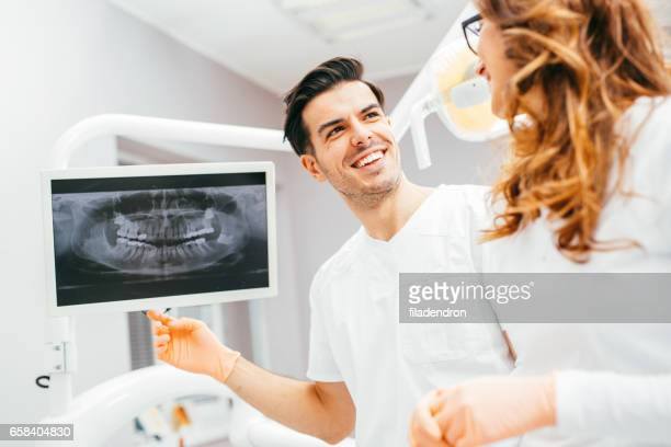Dentists looking at a digital x-ray