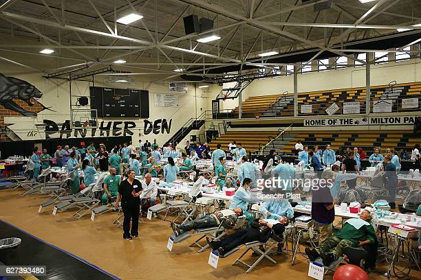 Dentists work on patients at the Remote Area Medical mobile dental and medical clinic on December 3 2016 in Milton Florida It is expected that over a...