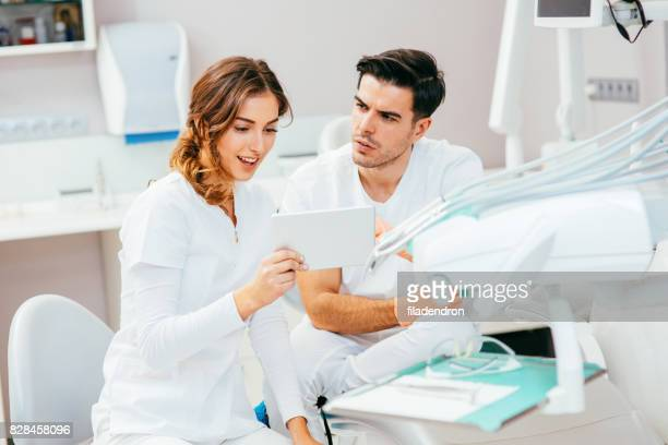 Dentists working on a tablet