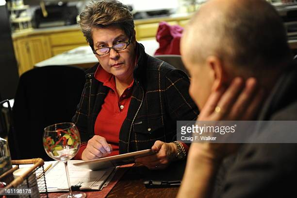Denver Athletics Club CEO General Manager Andre van Hall and his wife Nancy discuss their schedule for the week at their home in Littleton CO Tuesday...
