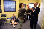 Denver Athletics Club CEO General Manager Andre van Hall highfives trainer Gina Fontaine after presenting her with an iPad for her outstanding job...
