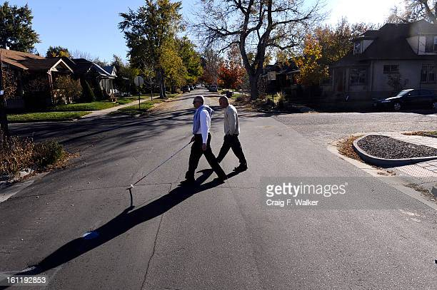 Denver Athletics Club CEO General Manager Andre van Hall left works with Orientation Mobility Specialist Ken Neve of the Colorado Department Human...