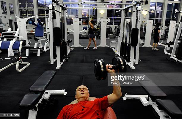 Denver Athletics Club CEO General Manager Andre van Hall lifts weights during his morning workout at the club in Denver CO November 10 2011 Andre...