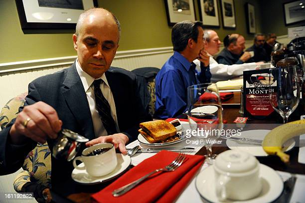 Denver Athletics Club CEO General Manager Andre van Hall prepares his coffee during a breakfast meeting at the club in Denver CO November 10 2011...