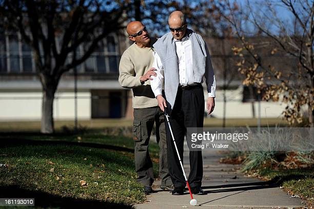 Denver Athletics Club CEO General Manager Andre van Hall right works with Orientation Mobility Specialist Ken Neve of the Colorado Department Human...
