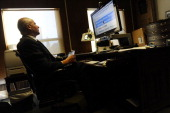 Denver Athletics Club CEO General Manager Andre van Hall works in his office at the club in Denver CO November 10 2011 Van Hall uses an Apple...