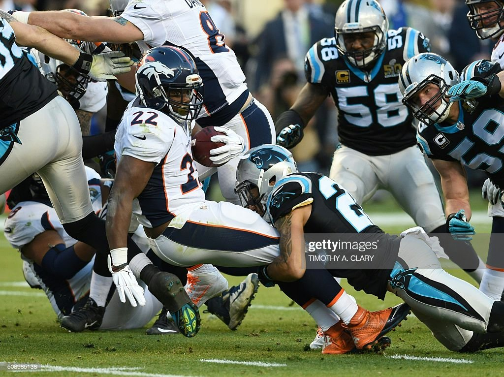 Denver Bronco C. J. Anderson (22) is tackled during Super Bowl 50 against the Carolina Panthers at Levi's Stadium in Santa Clara, California, on February 7, 2016. / AFP / TIMOTHY A. CLARY