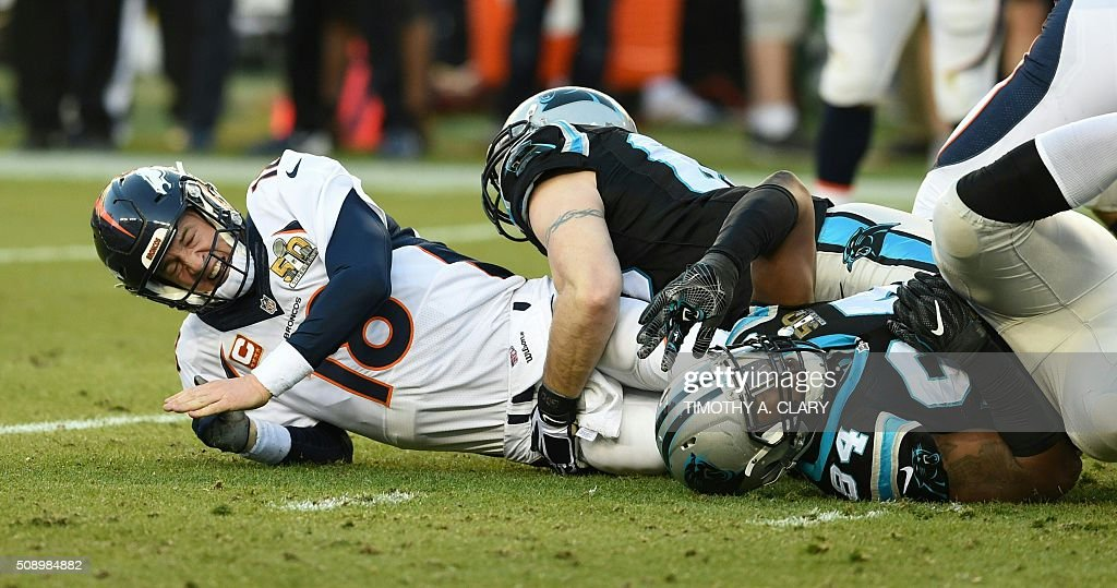 Denver Bronco Peyton Manning is tackled during Super Bowl 50 against the Carolina Panthers at Levi's Stadium in Santa Clara, California, on February 7, 2016. / AFP / TIMOTHY A. CLARY