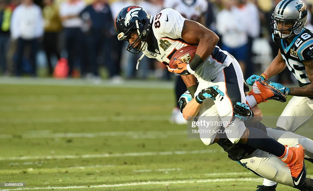 Denver Bronco Virgil Green (85) is tackled during Super Bowl 50 against the Carolina Panthers at Levi's Stadium in Santa Clara, California, on February 7, 2016. / AFP / TIMOTHY A. CLARY