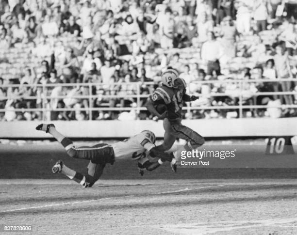Denver Broncos Alworth Gets in his One Big Shot During the Kill Cornerback Bill Thompson trips up flanker Lance Alworth at the Denver 4 Sunday after...