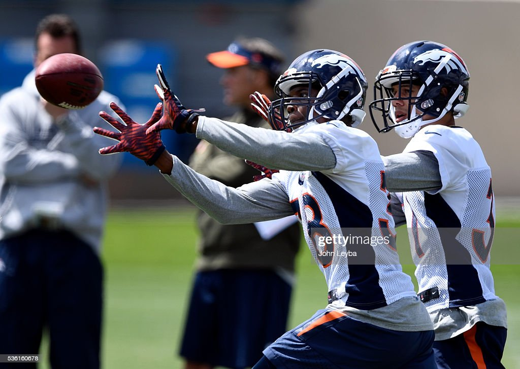 Denver Broncos Antonio Glover (38) works on drills with <a gi-track='captionPersonalityLinkClicked' href=/galleries/search?phrase=Justin+Simmons+-+American+Football+Free+Safety&family=editorial&specificpeople=15725444 ng-click='$event.stopPropagation()'>Justin Simmons</a> (31) during OTA's May 31, 2016 at UCHealth Training Facility, Dove Valley.