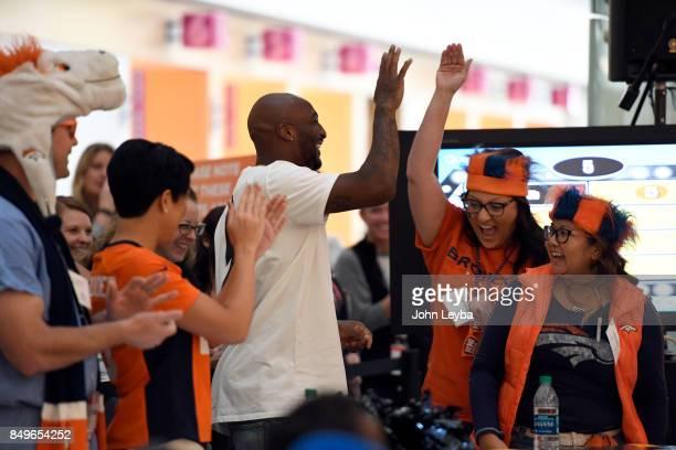 Denver Broncos Aqib Talib high fives a team member on September 19 2017 during the Childrens Hospital Colorado employees game of Family Feud Showdown...