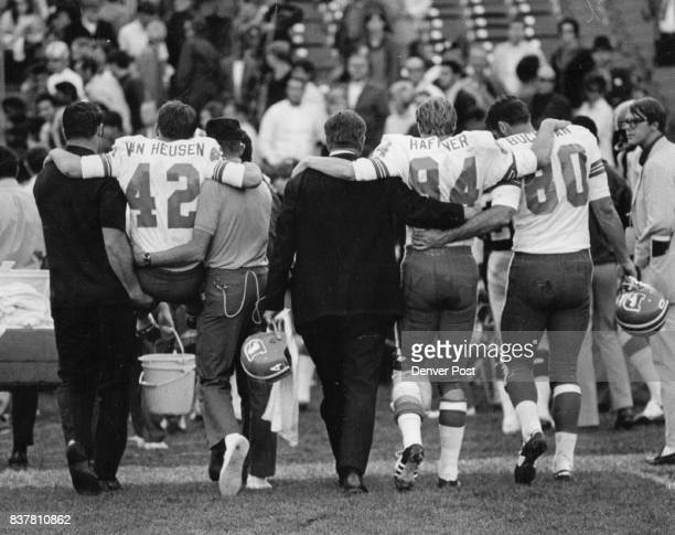 A Picture's Worth A Thousand Words Which All Adds Up To Disaster For Denver Broncos Wide receivers Billy Van Heusen and Mike Haffner are assisted off...