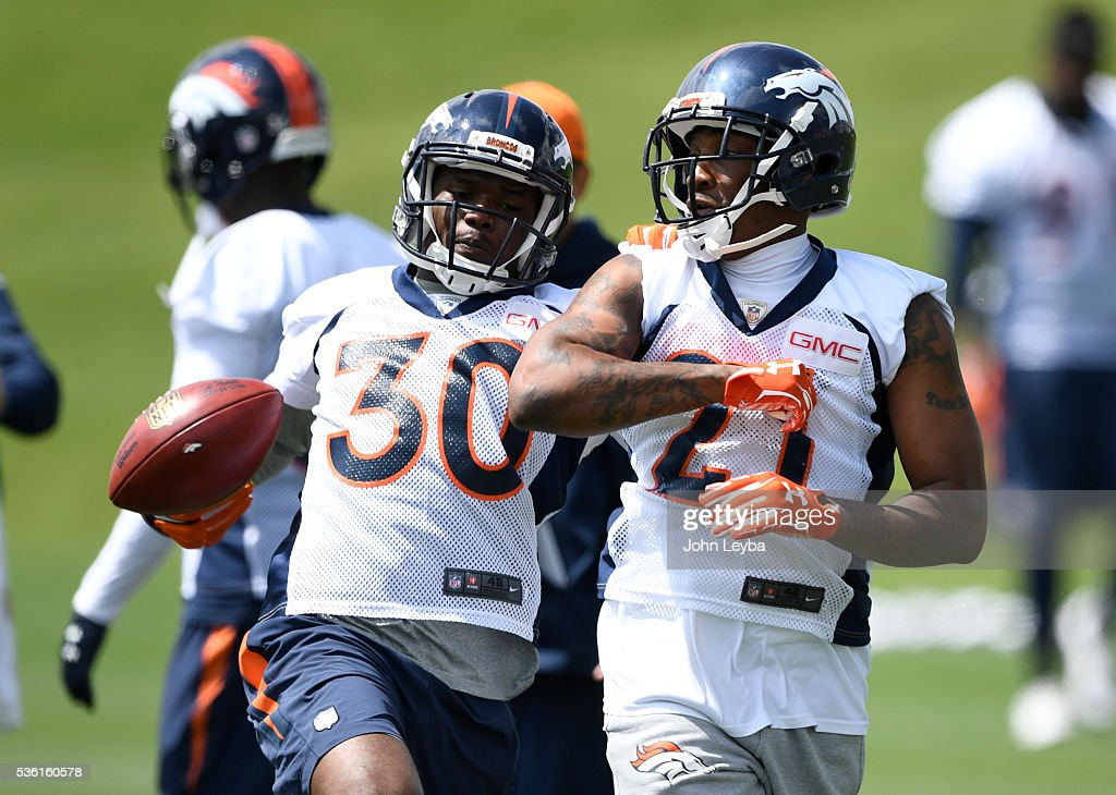 Denver Broncos B.J. Lowery (30) works on drills with Aqib Taleb (21) during OTA's May 31, 2016 at UCHealth Training Facility, Dove Valley.
